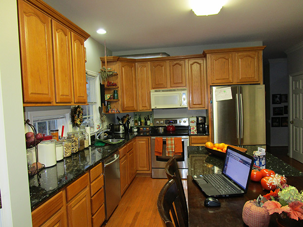 Before. Kitchen Cabinet Refinishing After